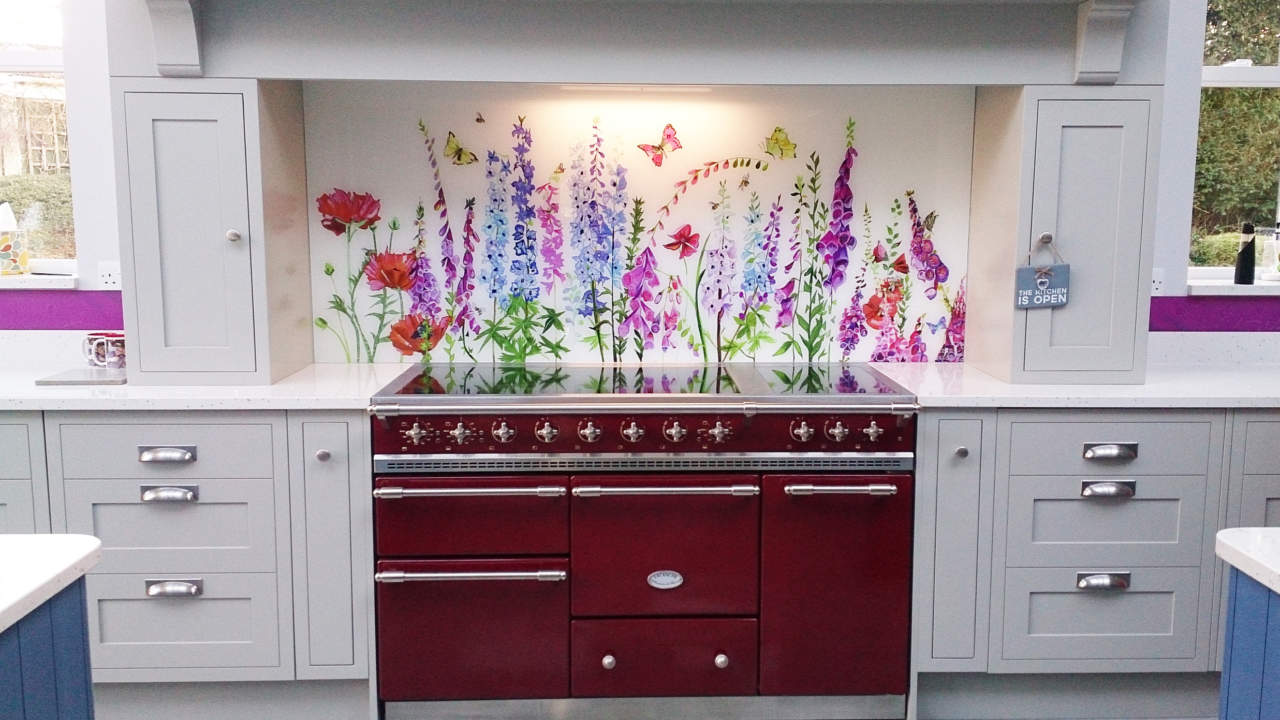 Bespoke Glass Splaskback Commission Norfolk behind a red range cooker in a country kitchen