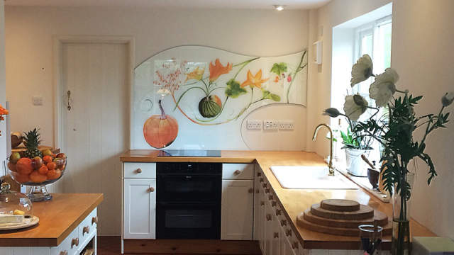Bespoke shaped kitchen glass splashback with autumnal design