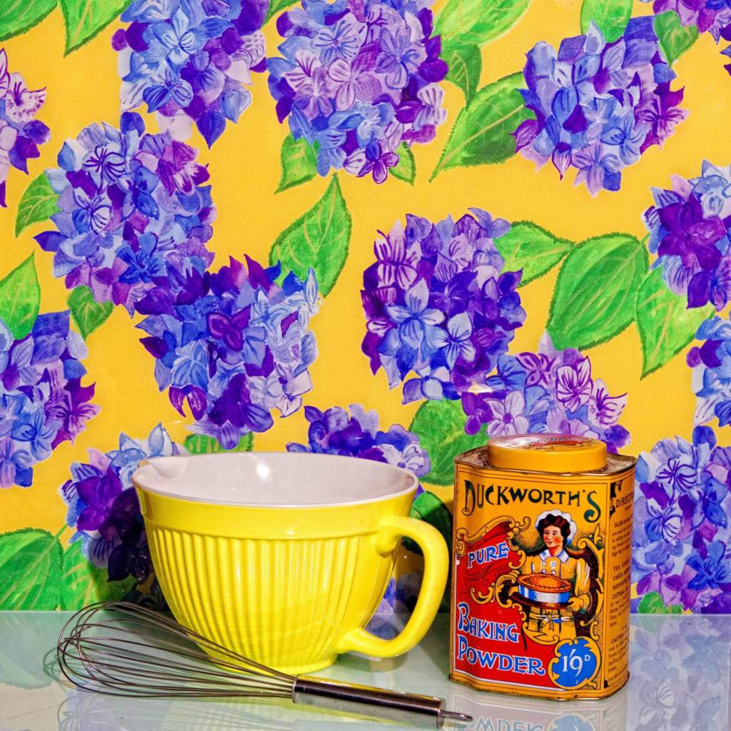 Yellow and Blue hydrangea glass splashback with baking bowl in kitchen